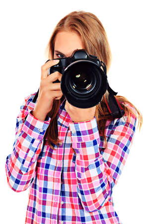 Pretty young woman taking pictures on the camera. Isolated over white. photo