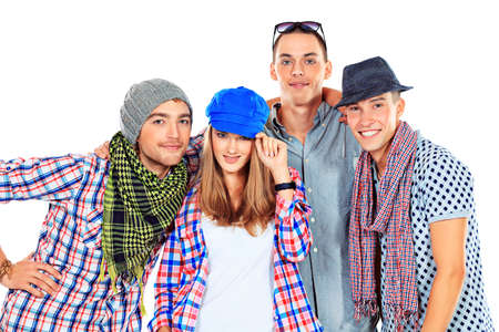 Group of cheerful young people standing together. Friendship. Isolated over white. photo