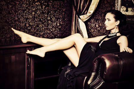 antique woman: Beautiful young woman in a  luxurious classic interior. Vintage style.