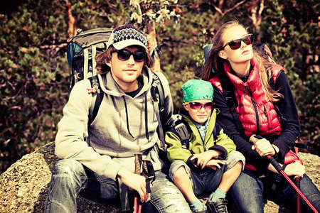 family activities: Happy parents hiking with their little son.
