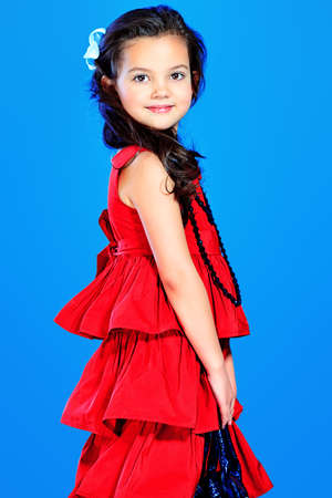 Portrait of a cute little girl in a beautiful dress. photo