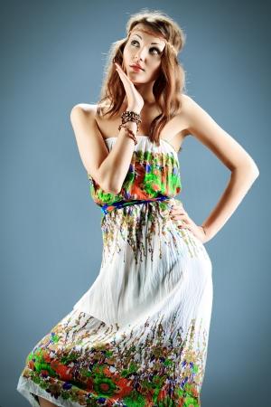 Portrait of a beautiful natural girl in light summer dress. Studio shot. Stock Photo - 19270821