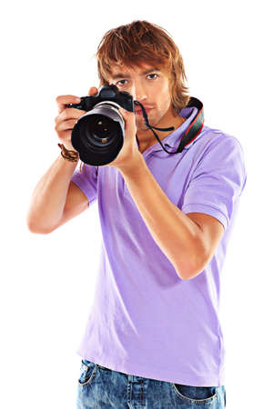 Handsome young man taking pictures on the camera. Isolated over white.