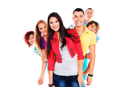 Large group of young people standing together in a row. Friendship. Isolated over white. photo