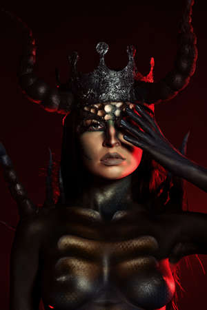 Beautiful and scary devil woman. Art project. photo