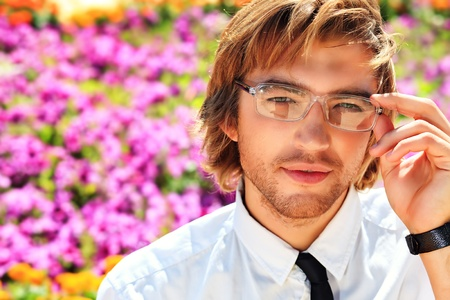 Portrait of a young business man over summer background. photo