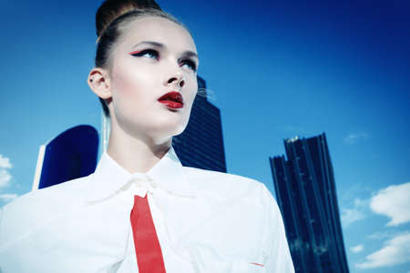 Portrait of a fashion model posing over big city background. photo