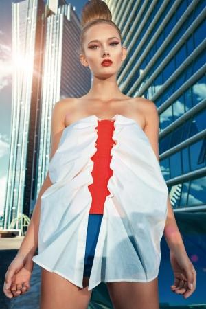 Fashion model posing over big city background. Stock Photo - 19562157