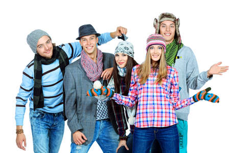 Group of cheerful young people in autumn clothes standing together. Friendship. Isolated over white. photo