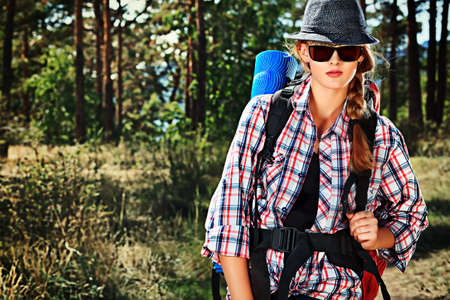 Beautiful girl tourist walking the trekking trail. Stock Photo - 19563696