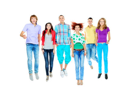 Group of cheerful young people jumping together. Isolated over white background. photo