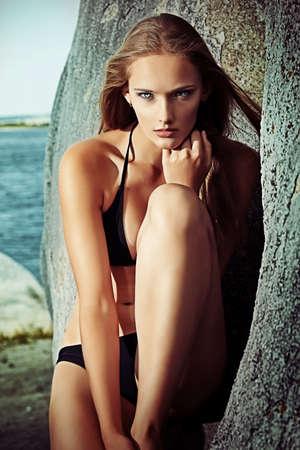Romantic beautiful woman sunbathing on a seaside. photo