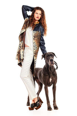 great dane: Beautiful young woman posing with her Great Dane dog. Isolated over white.