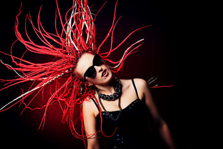 Expressive girl rock singer with great red dreadlocks. photo