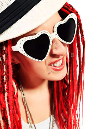 Portrait of a girl rock singer with great red dreadlocks. Isolated over white.  photo