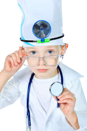 Portrait of a cute boy playing doctor with a stethoscope. Isolated over white. photo