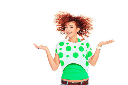 Portrait of a jumping young woman with beautiful curly red hair. photo
