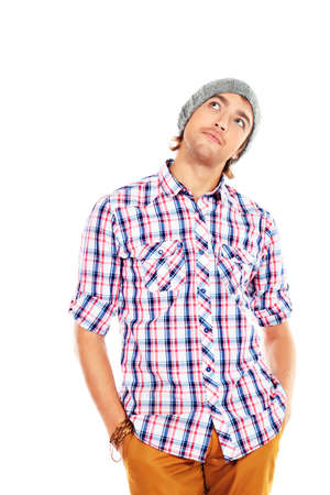 Portrait of a handsome young man in casual clothes. Isolated over white background. photo