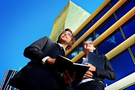 Business people standing in a big city over modern buildings  Stock Photo - 23945090