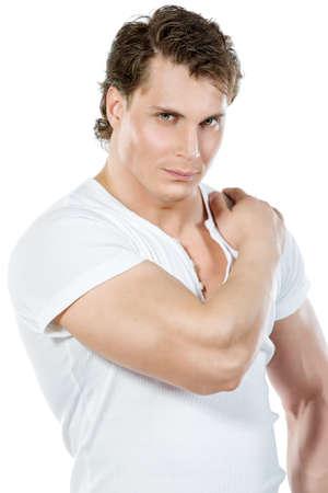 salud sexual: Retrato de un hombre guapo muscular. Aislado sobre fondo blanco.