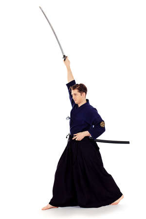 kendo: Handsome young man practicing kendo. Isolated over white. Stock Photo