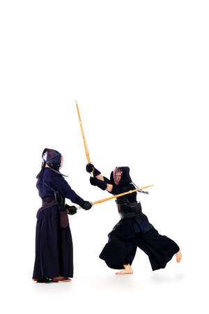 Two kendo fighters are fighting with each other. Asian martial arts. photo