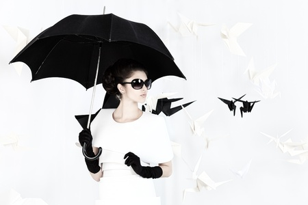Art fashion photo of a gorgeous woman in paper dress. Black and white. photo