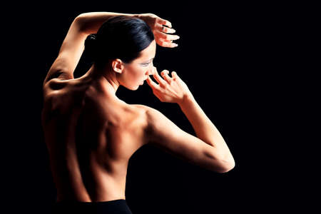 black women naked: Art portrait of a beautiful  woman back over black background.