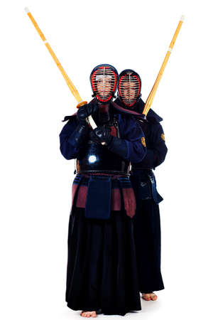 kendo: Two kendo fighters posing together over white background. Asian martial arts.