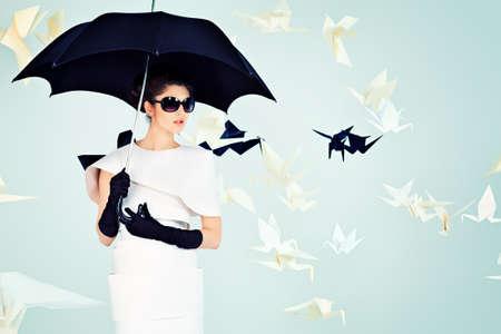 Art fashion photo of a gorgeous woman in paper dress photo