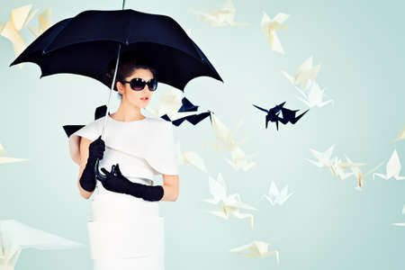 high fashion: Art fashion photo of a gorgeous woman in paper dress