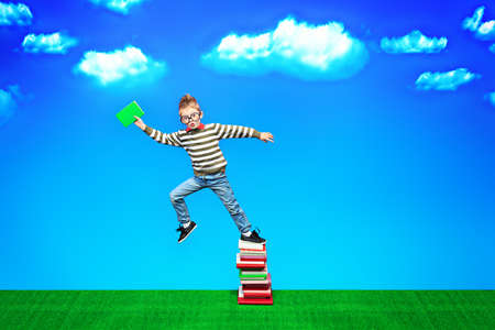 A boy with a book in hand is flying to knowledge photo