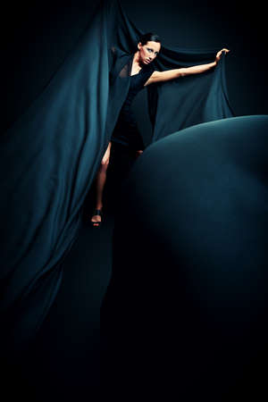 Art fashion photo of a beautiful woman in black dress Stock Photo - 20096571