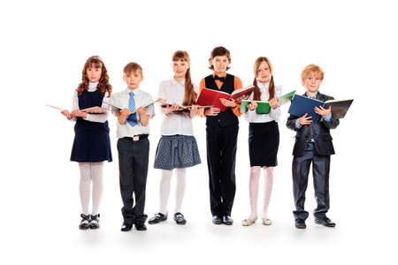 Group of happy schoolchildren with books. Education. Isolated over white background. photo