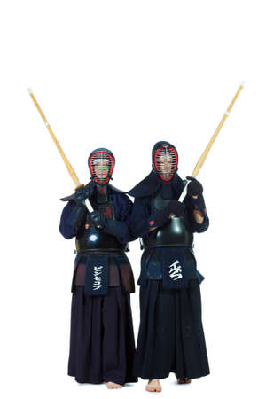 Two kendo fighters posing together over white background. Asian martial arts. photo