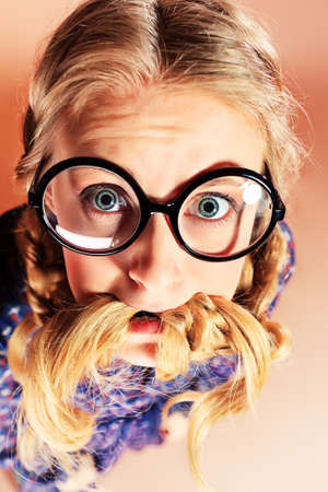 Portrait of a funny blonde girl in big round spectacles looking at camera. Retro style. photo