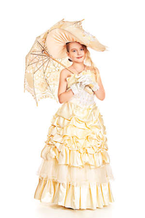 Portrait of a charming little lady in a beautiful elegant dress. Isolated over white. photo