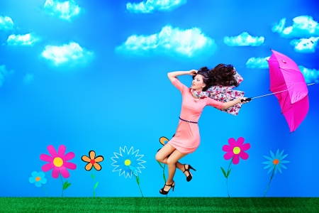 Romantic girl is running through the fabulous field of flowers. photo
