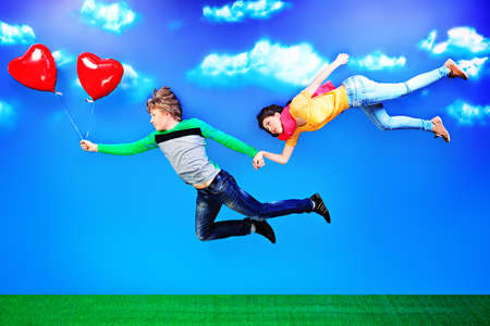 couple in summer: Couple of young people in love flying in the sky. Stock Photo
