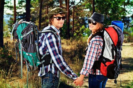 Couple of tourists follow the trekking trail. photo