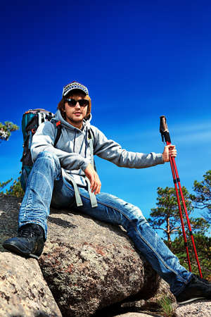 Handsome young man tourist making his journey at the mountains. photo