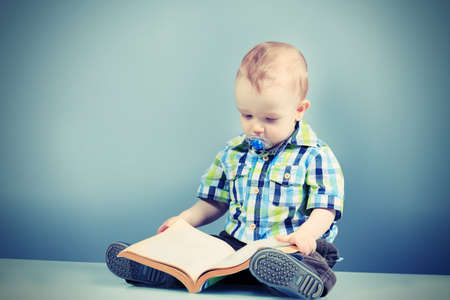 Portrait of a beautiful baby with a book Stock Photo - 20588378