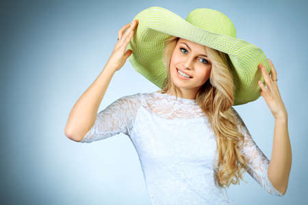Portrait of a pretty smiling young woman in summer clothes   photo