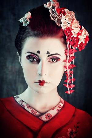 Art portrait of a stylized Japanese geisha. Body painting project.