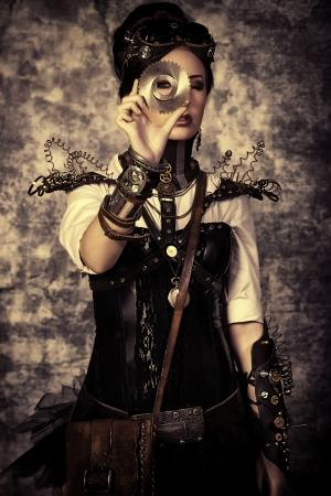 Retrato de una mujer hermosa steampunk sobre fondo grunge. Foto de archivo - 20990426