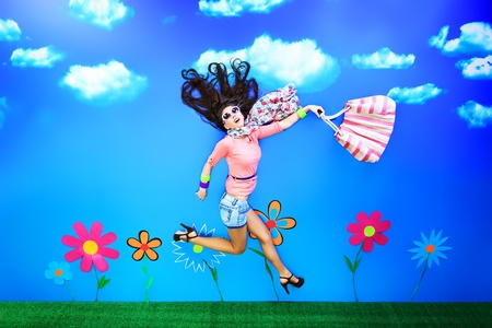 Romantic girl is running through the fabulous field of flowers.