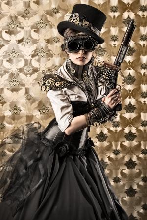 빈티지 배경 위에 총을 들고 아름 다운에 steampunk 여자의 초상화. 스톡 콘텐츠