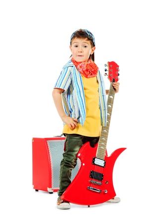 Cool little boy posing with electric guitar. Isolated over white background.