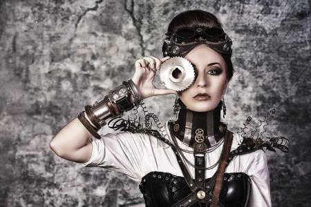 Retrato de una mujer hermosa steampunk sobre fondo grunge. Foto de archivo - 22484812