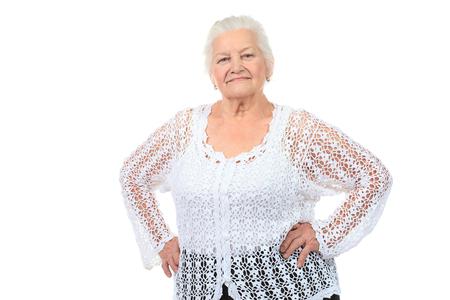 Mujer mayor feliz que sonr?e a la c?mara. Aislado en blanco. Foto de archivo - 22650109